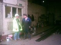 Contracts manager &  fabricator discuss an ongoing project